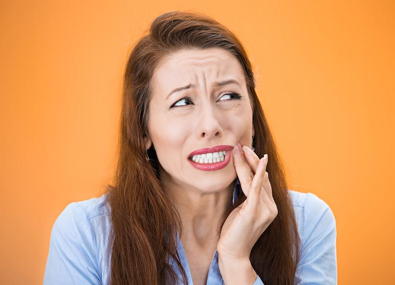 Woman with Mouth Pain | Ruggless Dental