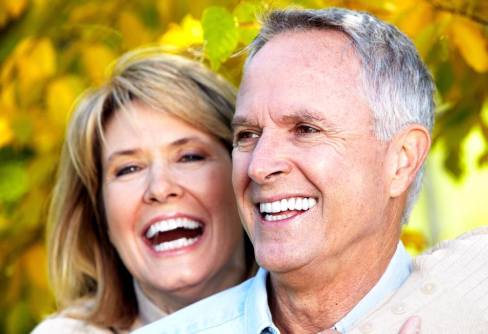 Couple Smiling Under a Tree | Cosmetic Dentist Springfield IL