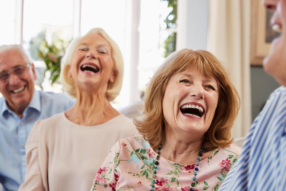 two older women smiling | dentures in Springfield IL