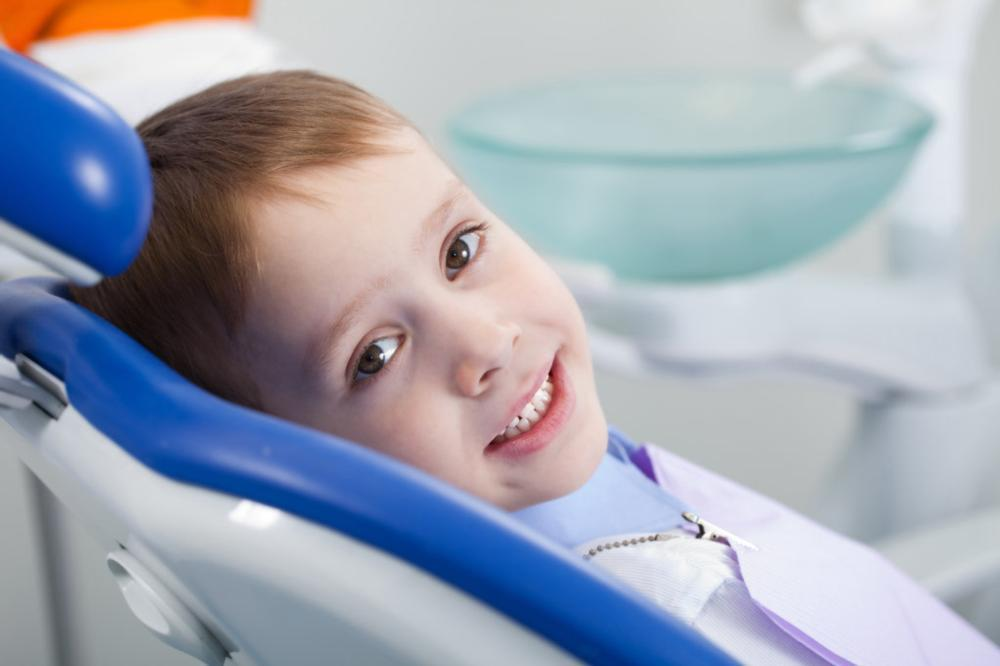 child smiling in dental chair