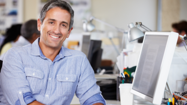 man sitting next to computer | dental extractions springfield il