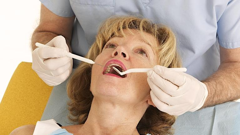 A Woman Gets Her Teeth Cleaned | Dentist Springfield IL