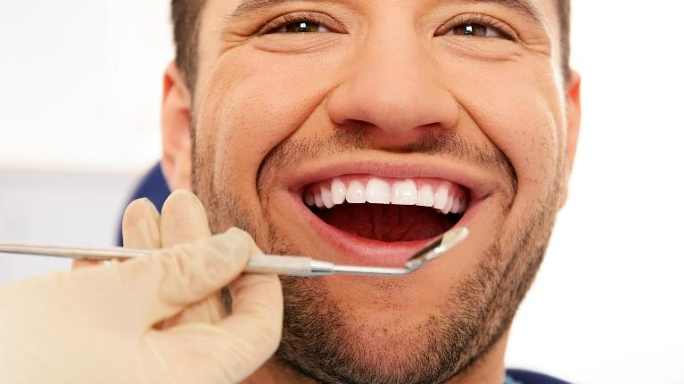 Man at Dentist | Ruggless Dental