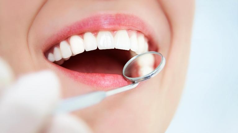 Woman Having Teeth Exam | Ruggless Dental