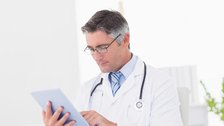 doctor holding clipboard | dentist springfield il