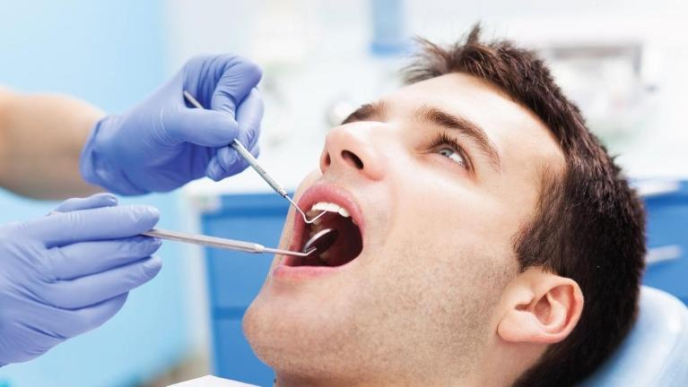 Man getting emergency dental care in Springfield, IL